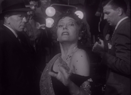 Gloria Swanson in a frame from the movie. Not the exaggerated quality of her face and body, suggesting both a silent film style, but also her unhinged mental state.