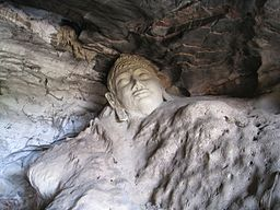 256px-60_buddha_head_carved_into_living_rock_9121945101